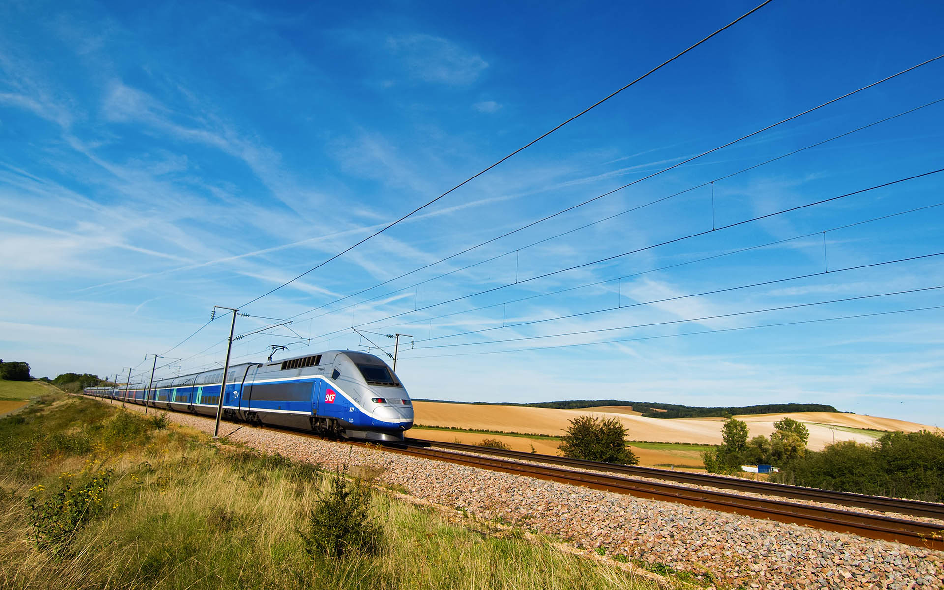 Sens, France - 15 September: A french high speed train passing through a field.